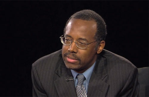 Photo shows Dr. Ben Carson speaking in an interview overcame all odds to become a neurosurgeon and, by age 33, director of pediatric neurosurgery at the Johns Hopkins Childrens Center.
