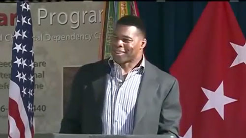 Photo shows Heisman Trophy winner and former NFL running back, Herschel Walker, speaking in Sept. 2013 at an Army Suicide Prevention event where Walker described his experience with Dissociative Personality Disorder.