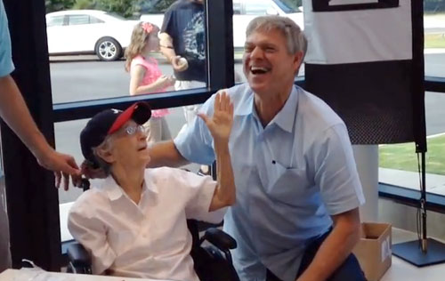 Photo shows former Atlanta Braves star, Dale Murphy, signing an autograph for long time fan Roselyn Buzzell of Augusta.