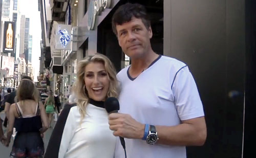 Photo shows NASCAR driver, Michael Waltrip, with dance partner, EmmaSlater, interviewing New Yorkers in Times Square.